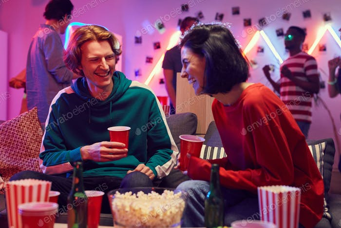 Young couple having fun at party