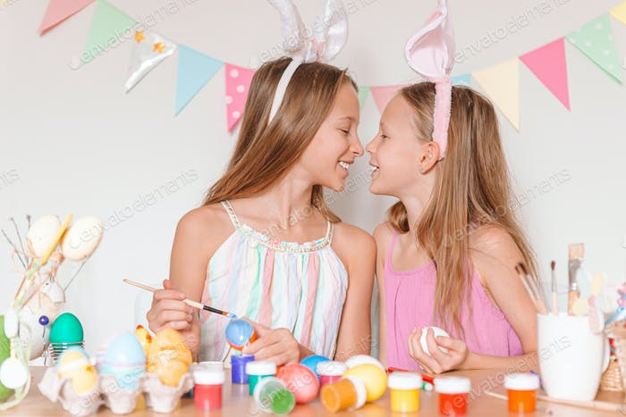 Happy easter. Beautiful little kids wearing bunny ears on Easter day