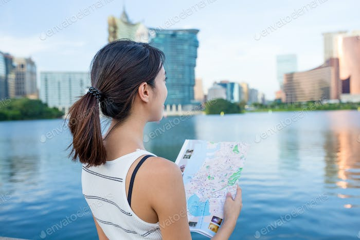 Woman looking for location in Macau
