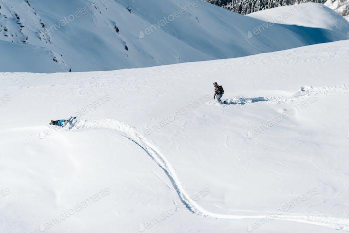 Sportsmen is walkig under the mountain