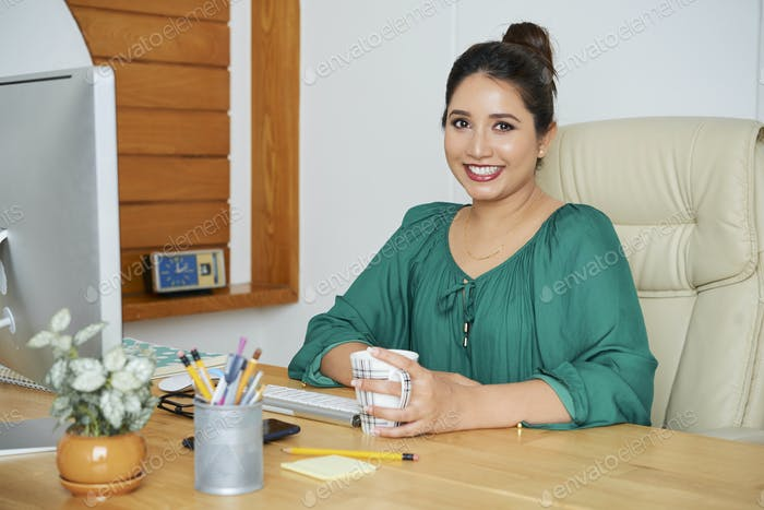 Businesswoman at workplace at office