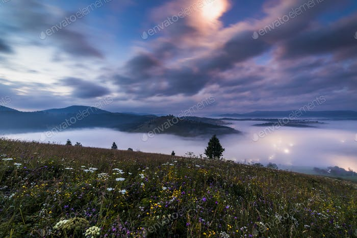 Misty dawn in the mountains. Beautiful Autumn Landscape