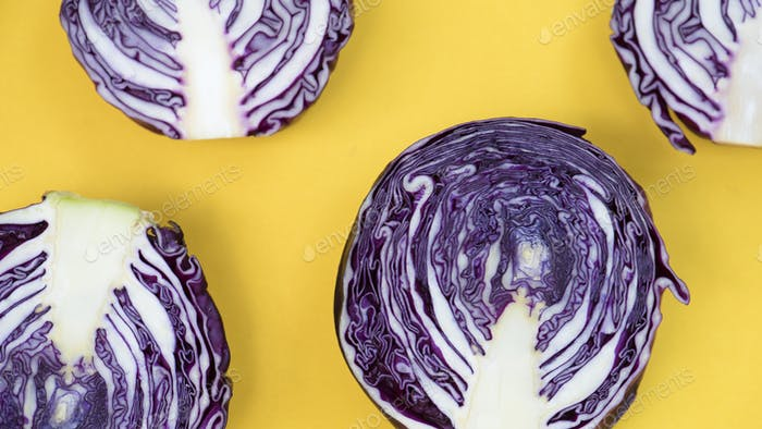 Closeup of fresh organic cabbage on yellow background