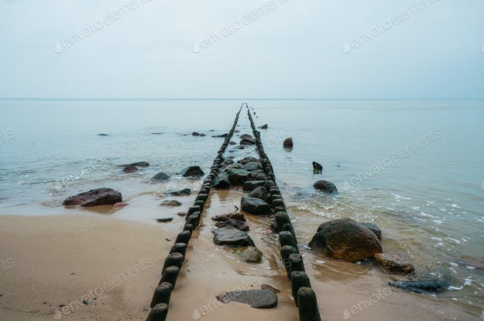 old wooden pier pillars on peaceful sea, Poland, Curonian Spit, september 2013