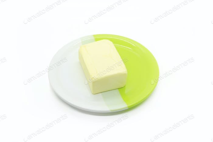 Piece of butter on a two-color plate
