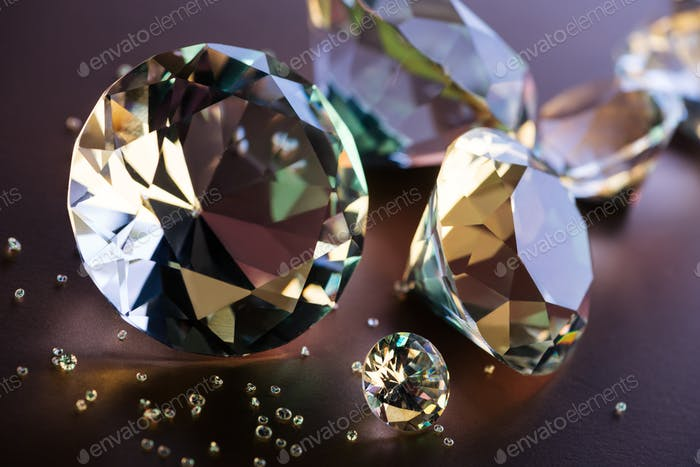 close up of big and small diamonds on brown background