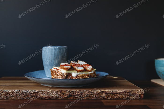 Healthy nutrition breakfast with espresso coffee and sandwich with cheese and turkey
