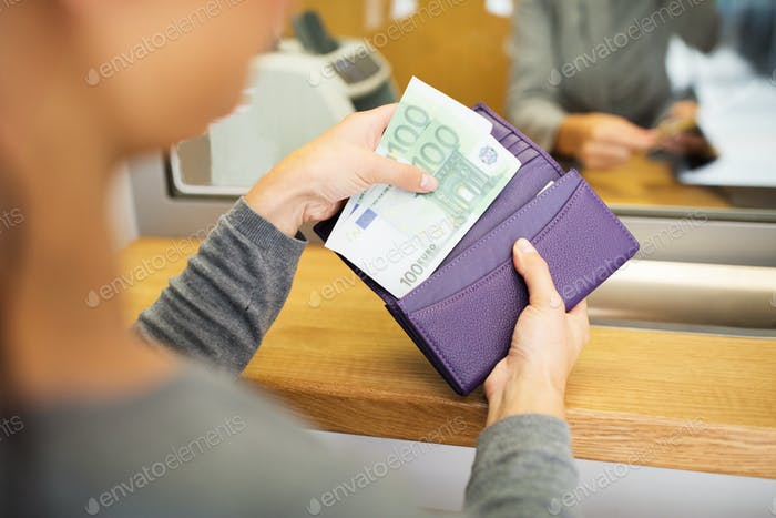 hands with money at bank or currency exchanger