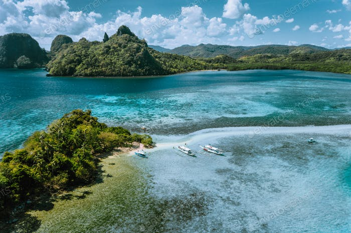 Aerial view of turquoise water and sandbar on tropical Vigan Snake Island, tourist attractions, tour