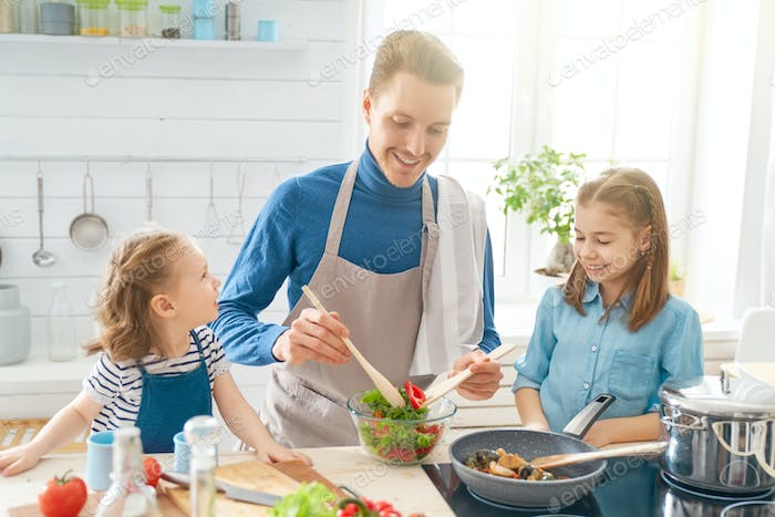 Happy family in the kitchen.