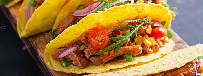 Taco. Mexican tacos with beef meat, corn and salsa. Mexican cuisine. Banner