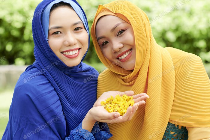 Muslim women with flower patals