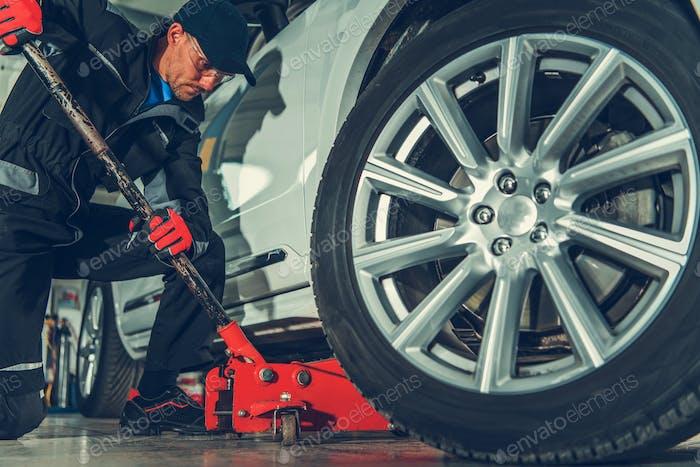 Mechanic with Floor Jack Lift