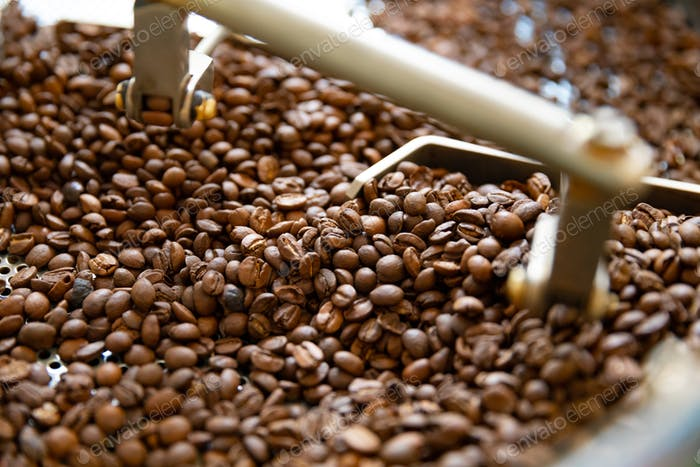 Close-up of Raw Coffee Beans In Roaster Machine
