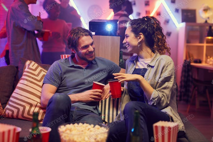 Couple talking at party