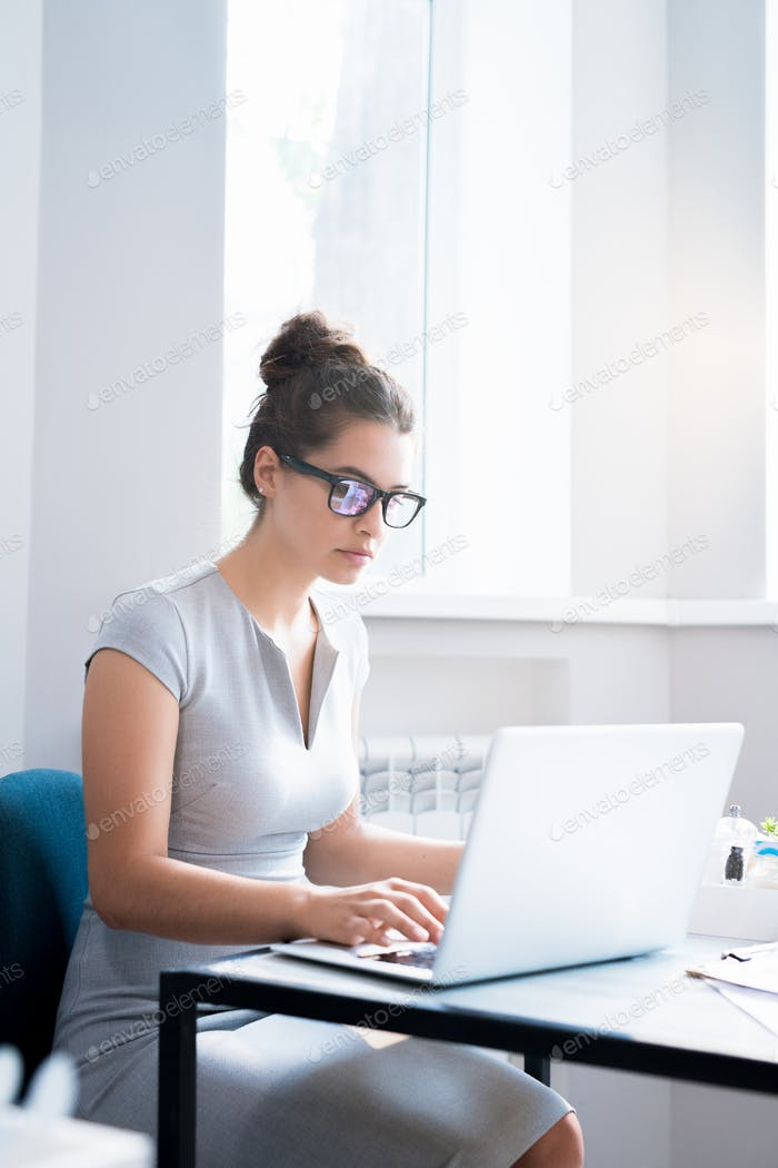 Latin-American Businesswoman Working in Cafe