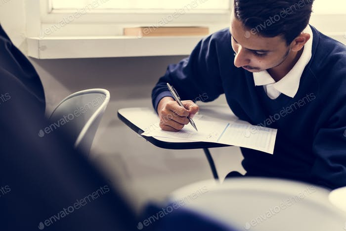 Young muslim student in class
