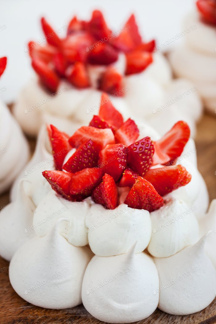 Pavlova meringue cake decorated with fresh strawberries