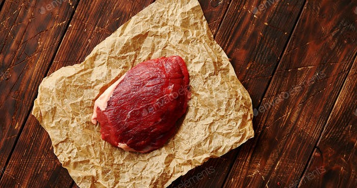 Piece of raw meat on paper napkin
