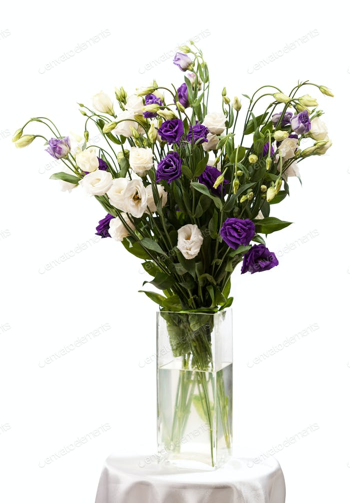 Bouquet of eustoma flowers in vases, isolated on white
