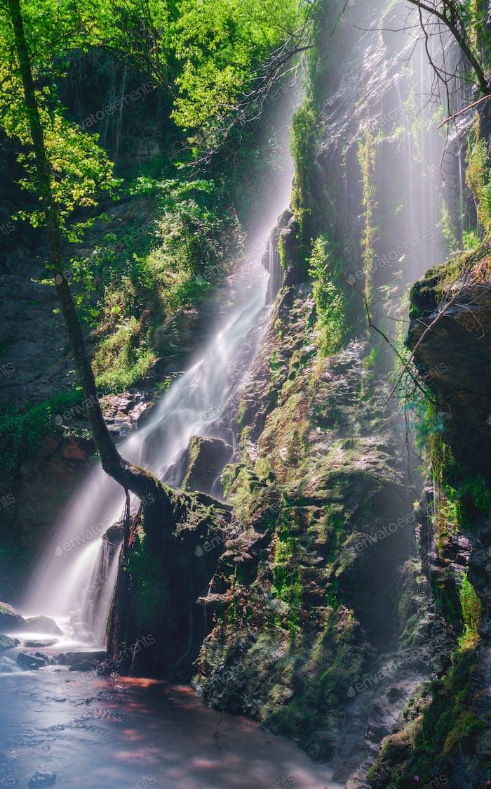 Sunbeams through the waterfall
