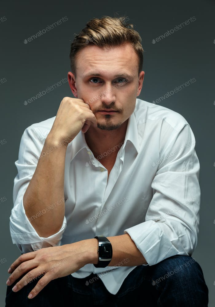 Portrait of a man in shirt.