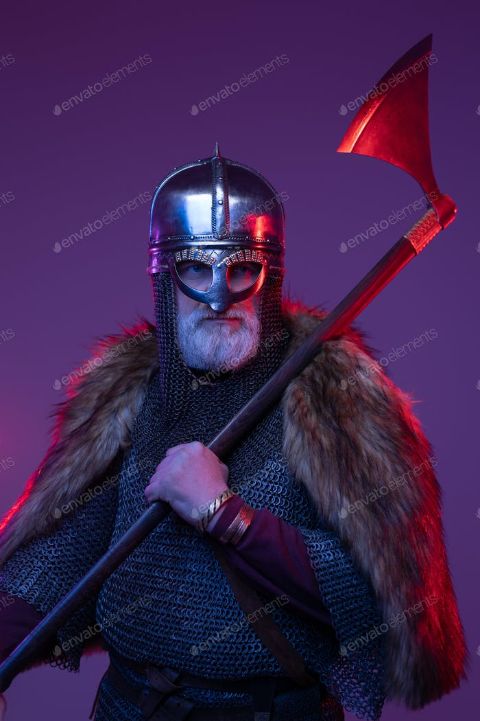 Medieval old warrior wielding axe against purple background