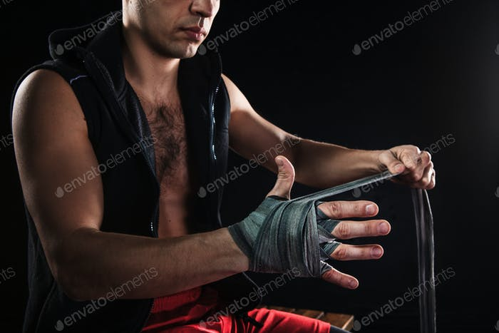 The hands of muscular man with bandage