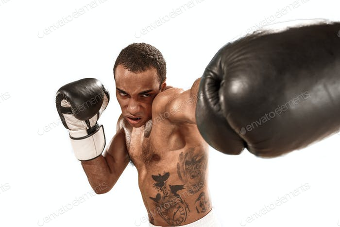 Sporty man during boxing exercise. Photo of boxer on white background