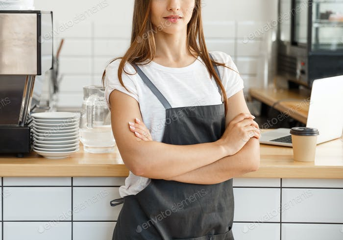 Coffee Business owner Concept - attractive young beautiful caucasian barista in apron with confident