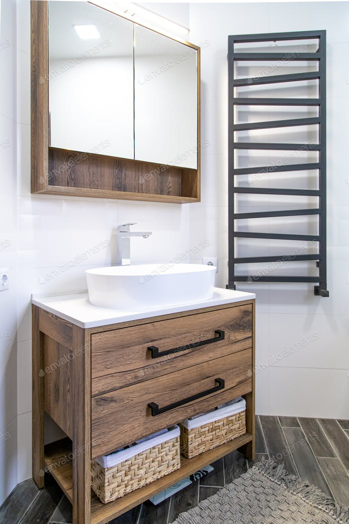 Modern bathroom interior with wooden furniture close up.