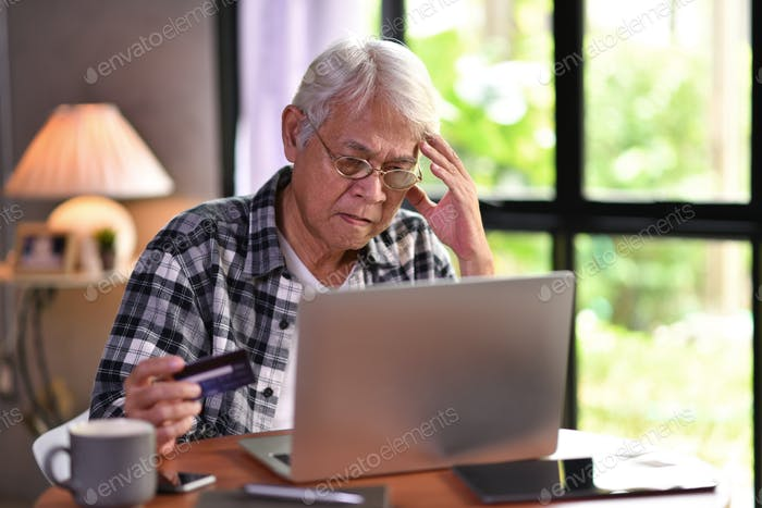 Senior man with credit card