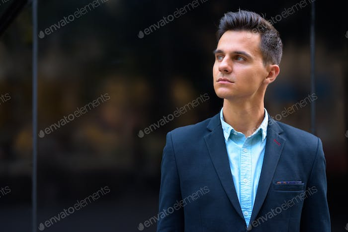Young handsome businessman exploring the city