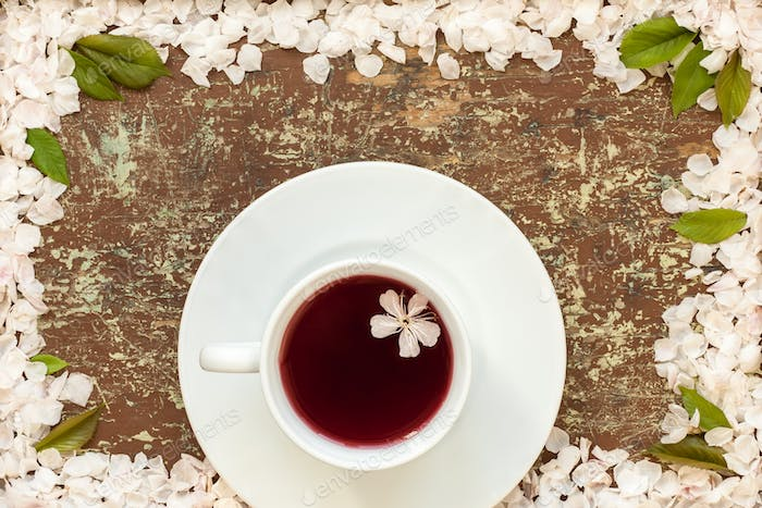 Cup of fruit tea and cherry blossom