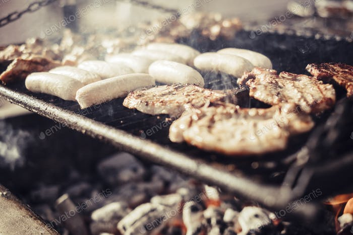 Close up of barbecue meat grill with fire and carbon . delicious food to eat in friendship