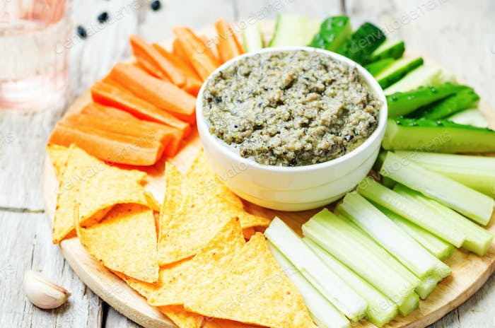 black bean dip with vegetables and corn chips