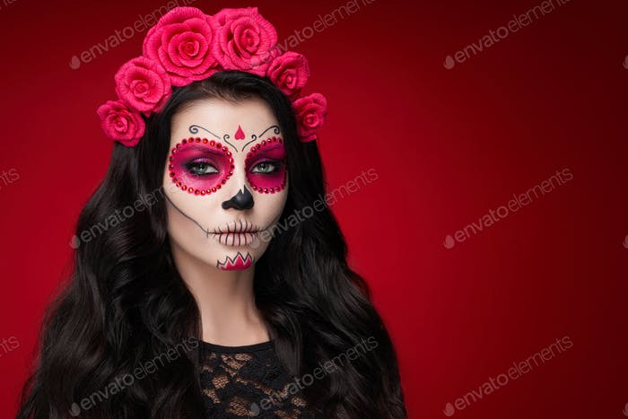 Portrait of a woman with makeup sugar skull