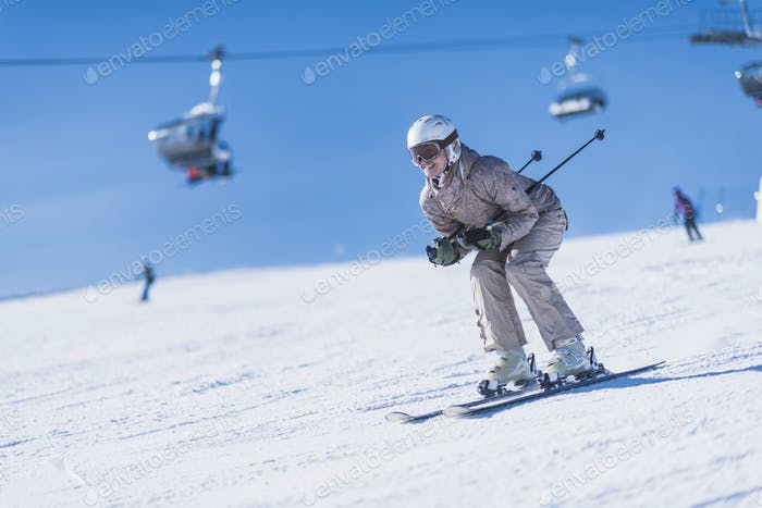 Female Skier Skiing Down the Slope