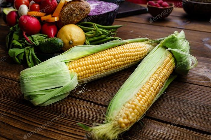 Fresh corncob on wooden background