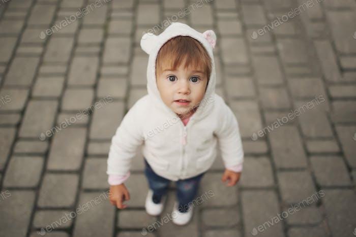 cute little girl in hood with ears