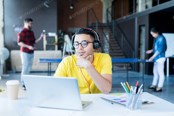 Creative Middle-Eastern Man Working in Office