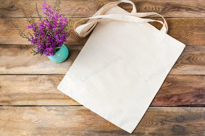 Rustic tote bag mockup with purple flowers