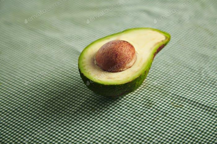 Avocado half on a checkered tablecloth