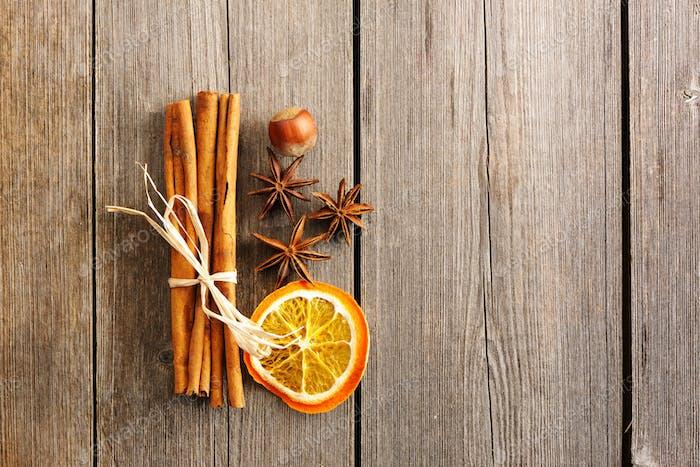 Cinnamon sticks over wooden table