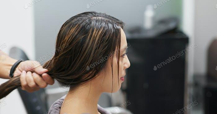 Woman having hair treatment in hair salon