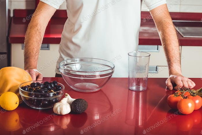 The young man prepared the ingredients to cook