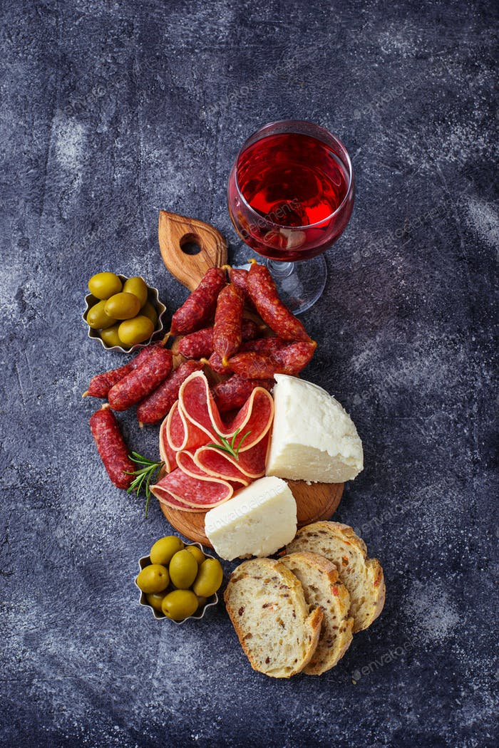 Selection of Italian appetizer. Wine snack set.
