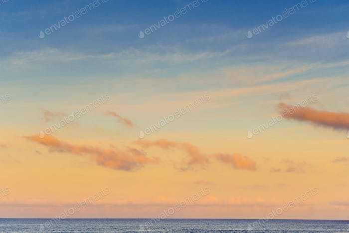 Orange sky, above the blue sea