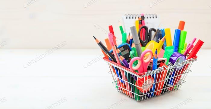 School shopping basket on white background