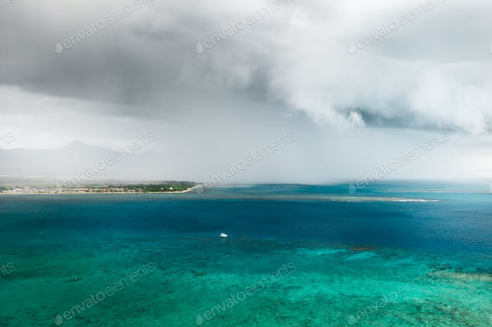 A thunderstorm approaching the coast of the island of Mauritius in the Indian Ocean